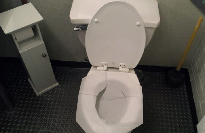 never-put-toilet-paper-on-a-toilet-seat-again